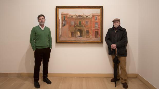 Francisco L. González-Camaño y José Luis Mauri junto a una obra de Joaquín Sáenz