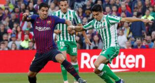 Luis Suárez, Guardado y Bartra, en el Barcelona-Betis (Reuters)