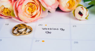 Word Wedding to Reminder Wedding day with Wedding ring on calendar planning and office tool.