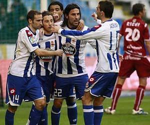 Sevilla FC: Juan Rodríguez celebra un gol con sus compañeros