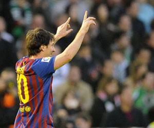 Messi celebra un gol ante el Racing de Santander