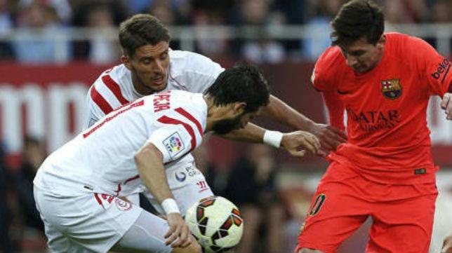 Carriço y Pareja, en un partido ante el Barcelona de Messi