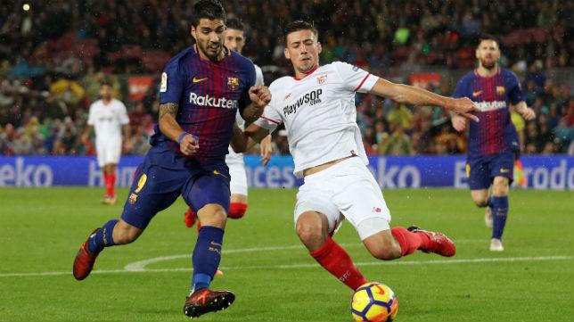 Lenglet y Luis Suárez, en el Barcelona-Sevilla (Reuters)