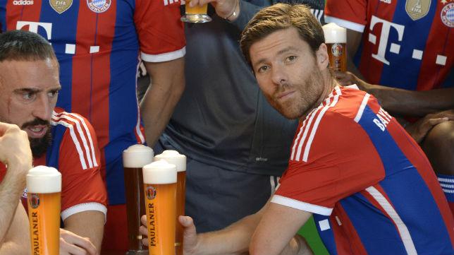 Xabi Alonso, junto a Ribery, en su etapa en el Bayern (AFP)