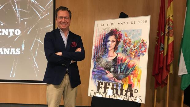 Juan Miguel Martín Mena junto a su cartel de Feria de Dos Hermanas