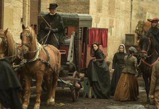 A la derecha, el guardadamas de la señora, a caballo